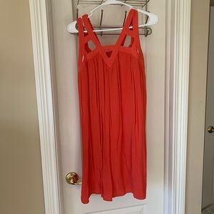 Coral sun dress with fun detailing on straps